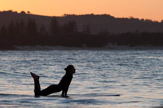 relaxing on surfboard at Byron Bay, Australia