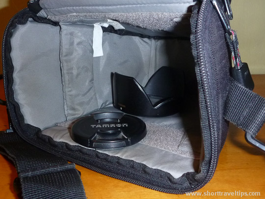 Empty camera case, lens cap and hood