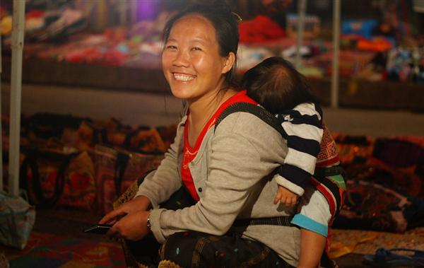 smiling lady carrying baby