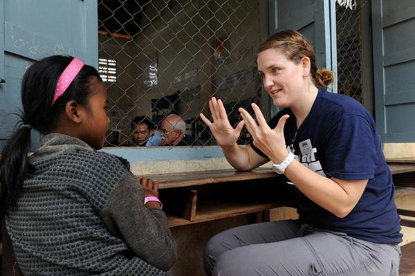 Project HOPE volunteer plays with a Cambodian girl